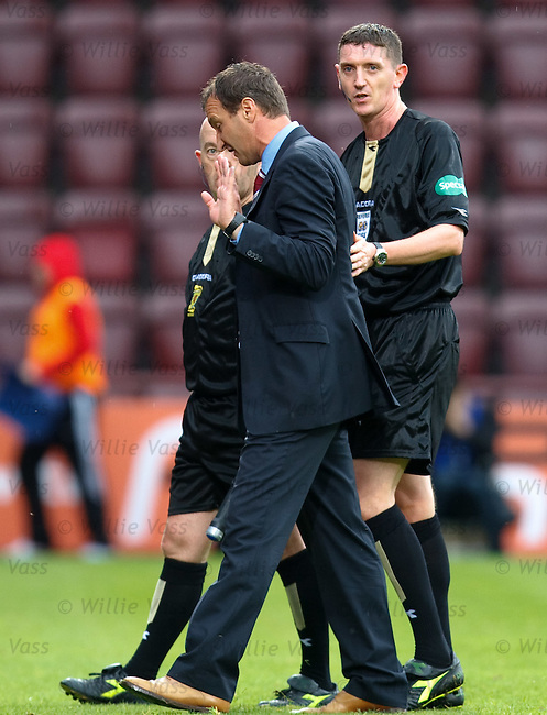 Hearts manager Csaba Laszlo confronts referee Craig Thomson and his linesman on the pitch at the end of the match