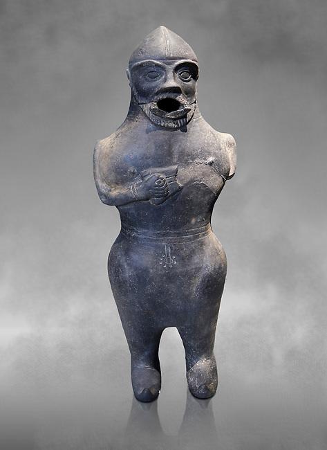 Anthropomorphic Hittite jug in terra cotta from the Hittite Period. Adana Archaeology Museum, Turkey. Against a grey art background