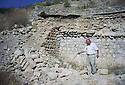 Iraq 2000  Father Petros Harbol showing the ruins of the church in Sharanesh. The Christian village was destroyed by the Iraqi army.    Irak 2000 Le pere Petros Harbol montrant les ruined de l'eglise du village de Sharanesh, detruit par l'armee irakienne