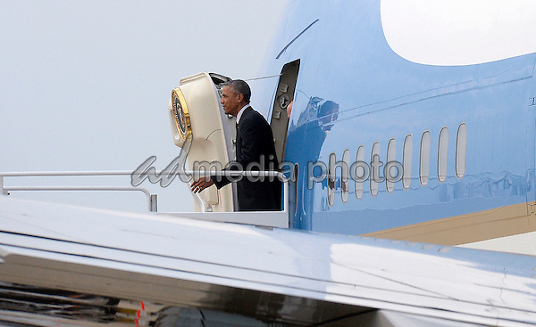 United States President Barack Obama exits Air Force One as he returns from Atlanta, on August 1, 2016 at Joint Base Andrews in Maryland. Photo Credit: Olivier Douliery/CNP/AdMedia