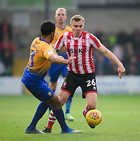 Lincoln City's Harry Anderson vies for possession with Mansfield Town's Malvind Benning<br /> <br /> Photographer Chris Vaughan/CameraSport<br /> <br /> The EFL Sky Bet League Two - Lincoln City v Mansfield Town - Saturday 24th November 2018 - Sincil Bank - Lincoln<br /> <br /> World Copyright &copy; 2018 CameraSport. All rights reserved. 43 Linden Ave. Countesthorpe. Leicester. England. LE8 5PG - Tel: +44 (0) 116 277 4147 - admin@camerasport.com - www.camerasport.com