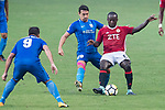 Eugene Mbende Mbome of Pegasus (R) fights for the ball with SC Kitchee Midfielder Lam Matthew Thomas (C) during the week three Premier League match between Hong Kong Pegasus and Kitchee at Hong Kong Stadium on September 17, 2017 in Hong Kong, China. Photo by Marcio Rodrigo Machado / Power Sport Images