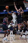 Keyshawn Woods (1) of the Wake Forest Demon Deacons passes the ball as he is defended by Grant Golden (33) of the Richmond Spiders during second half action at the LJVM Coliseum on December 2, 2017 in Winston-Salem, North Carolina.  The Demon Deacons defeated the Spiders 82-53.  (Brian Westerholt/Sports On Film)