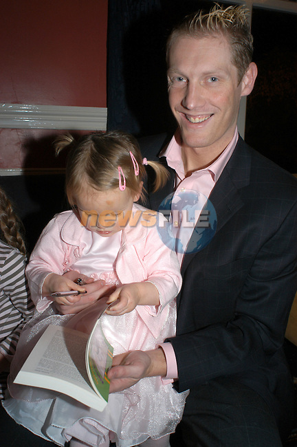18-11-03 - Launch of Graham Geraghty biography 'Misunderstood' at the Old Darnley Lodge Hotel, Athboy, County Meath..Signing a copy of Daddy's book is daughter Lauren. .Photo:Barry Cronin/Newsfile.