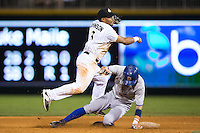 Micah Johnson (3) of the Charlotte Knights makes a throw to first base as Nick Franklin (6) of the Durham Bulls slides into second base at BB&T BallPark on July 22, 2015 in Charlotte, North Carolina.  The Knights defeated the Bulls 6-4.  (Brian Westerholt/Four Seam Images)