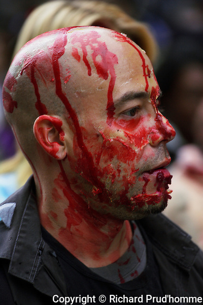 A bleeding bald head male participating in the Montreal zombie walk