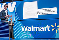 NWA Democrat-Gazette/CHARLIE KAIJO Chairman of the Walmart Inc. Board of Directors Gregory B. Penner speaks during the Walmart shareholders meeting, Friday, June 7, 2019 at the Bud Walton Arena in Fayetteville.