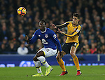 Romelu Lukaku of Everton tussles with Gabriel Paulista of Arsenal during the English Premier League match at Goodison Park Stadium, Liverpool. Picture date: December 13th, 2016. Pic Simon Bellis/Sportimage
