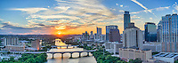 This is a aerial panorama of the Austin Cityscape in downtown along LadyBird Lake as the sun was setting with this gorgeous sunset.  You can see the city high-rises as they run along the waterfront along with the many bridges that span the lake, like the Congress bridge, all the way down to the Lamar Street Bridge .  The many well known high-rise building or also in site such as Austin tallest building the Austonian, the 360 Condos, the W, the Marriott, Frost, Four Season, Hyatt and many more.