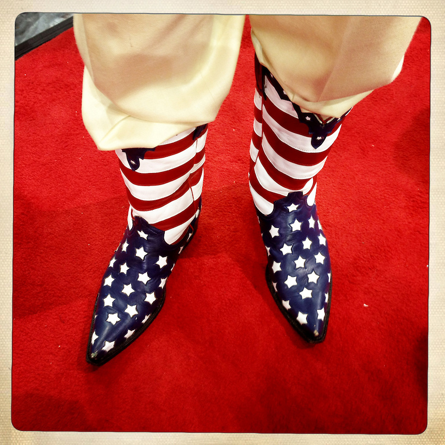 A delegate from California wears cowboy boats decorated with the American flag at the Republican National Convention in Tampa, Fla.