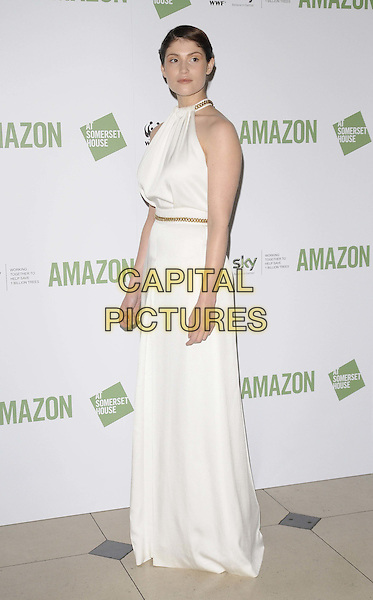 Gemma Arterton.Amazon exhibition private view in aid of the Sky Rainforest Rescue, Somerset House, Strand, London, England.1st November 2011.full length white sleeveless dress top skirt gold belt side .CAP/CAN.©Can Nguyen/Capital Pictures.
