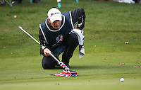 Caddie Dermot eyes the line for Shane Lowry (IRL) on the 17th during the Final Round of the British Masters 2015 supported by SkySports played on the Marquess Course at Woburn Golf Club, Little Brickhill, Milton Keynes, England.  11/10/2015. Picture: Golffile | David Lloyd<br /> <br /> All photos usage must carry mandatory copyright credit (© Golffile | David Lloyd)
