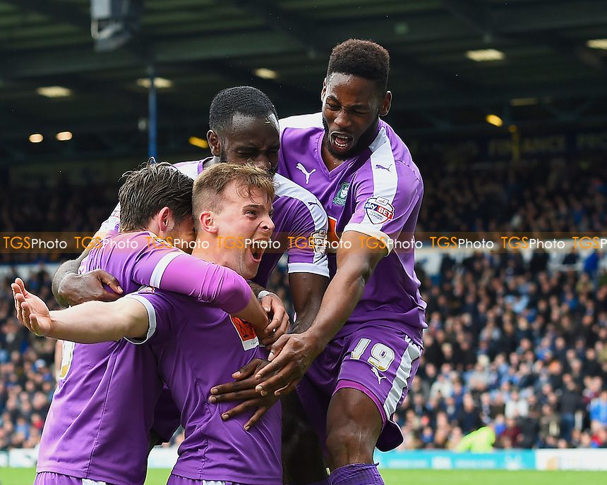 Gregg Wylde of Plymouth Argyle middle celebrates with team mates after scoring the second and winning goal during Portsmouth vs Plymouth Argyle, Sky Bet League 2 Football at Fratton Park on 16th April 2016