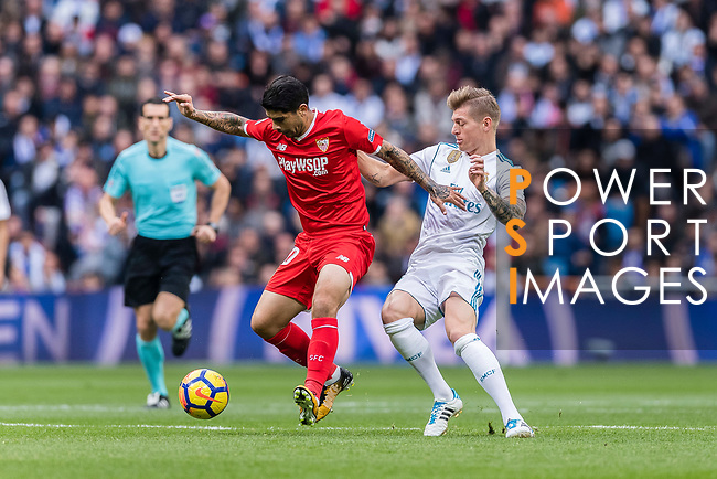 Ever Banega of Sevilla FC (L) fights for the ball with Toni Kroos of Real Madrid (R) during the La Liga 2017-18 match between Real Madrid and Sevilla FC at Santiago Bernabeu Stadium on 09 December 2017 in Madrid, Spain. Photo by Diego Souto / Power Sport Images