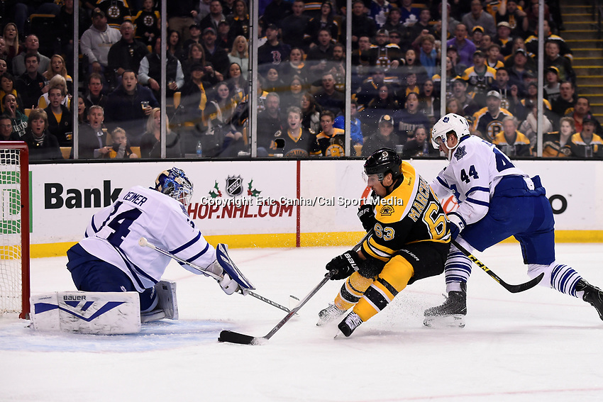 Saturday, November 21, 2015: Boston Bruins left wing Brad Marchand (63) attacks the net and Toronto Maple Leafs goalie James Reimer (34) during the National Hockey League game between the Toronto Maple Leafs and the Boston Bruins held at TD Garden, in Boston, Massachusetts.  Eric Canha/CSM