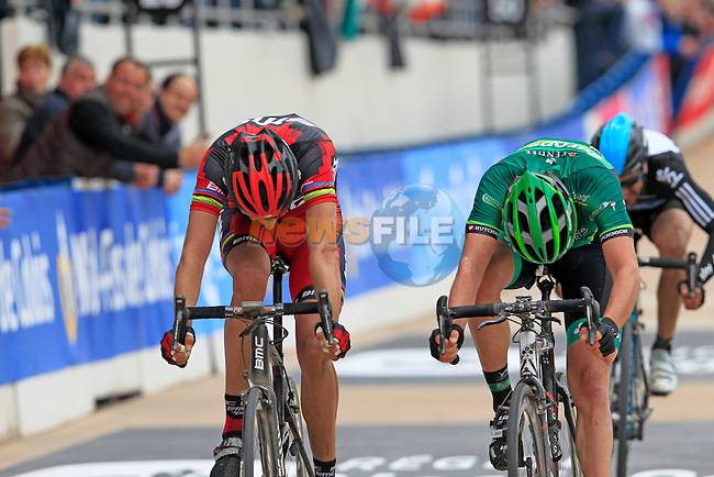 The chasing pack led by Sbastien Turgot (FRA) Team Europcar outsprints Alessandro Ballan (ITA) BMC Racing for the line in the Roubaix Velodrome at the end of the 110th edition of the Paris-Roubaix spring classic cycle race. 8th April 2012 (Photo by Eoin Clarke 2012)