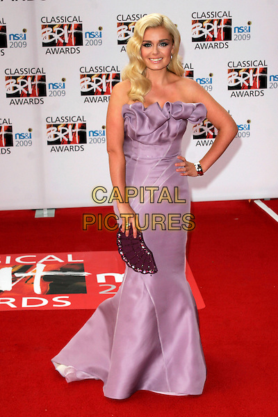 KATHERINE JENKINS.Arrivals - the Classical Brit Awards 2009 at the Royal Albert Hall, London, England..May 14th 2009.brits full length purple ruffle strapless dress lilac fan clutch bag silk satin hand on hip gathered .CAP/AH.©Adam Houghton/Capital Pictures.