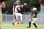Palos Verdes, CA 11/04/11 - Nick Roos (West Torrance #4) and Ryan Augello (Peninsula #29) in action during the West Torrance vs Peninsula varsity football game.