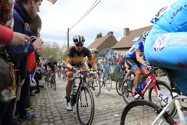 The peleton, including Stijn Devolder (BEL) Trek Factory Racing, climb the Molenberg during the 2014 Tour of Flanders, Belgium.<br /> Picture: Eoin Clarke www.newsfile.ie