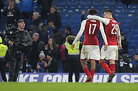 Granit Xhaka of Arsenal puts his arm around Alex Iwobi as they leave the final at the end of the game during Chelsea vs Arsenal, Caraboa Cup Football at Stamford Bridge on 10th January 2018