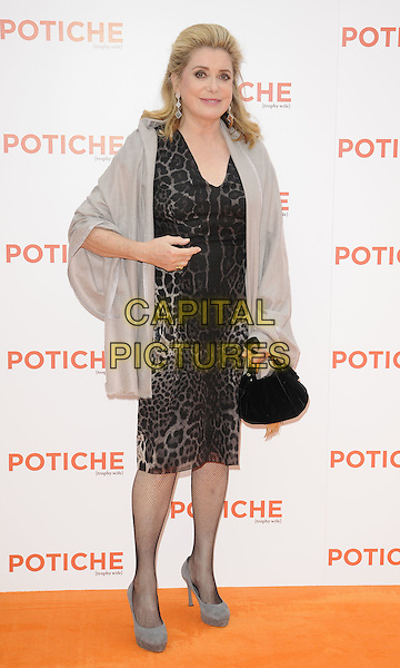 "Catherine Deneuve .At the UK Film Premiere of ""Potiche"", BFI Southbank, London, England, UK, .15th June 2011..full length grey gray wrap leopard print animal dress  black bag handbag shoes hand .CAP/CAN.©Can Nguyen/Capital Pictures."