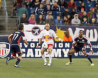 New York Red Bulls substitute midfielder Joel Lindpere (20) collects a pass as New England Revolution defender Darrius Barnes (25) defends. Despite a red-card man advantage, in a Major League Soccer (MLS) match, the New England Revolution tied New York Red Bulls, 1-1, at Gillette Stadium on September 22, 2012.
