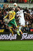 Thursday 24 October 2013  <br /> Pictured: ( L-R )  Ivelin Popov of Kuban Krasnodar and Jose Canas in a mid air clash<br /> Re:UEFA Europa League, Swansea City FC vs Kuban Krasnodar,  at the Liberty Staduim Swansea