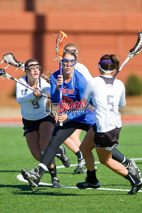 Shannon Gilroy (8) of the Florida Gators is surrounded by High Point Panthers defenders during second half action against the High Point Panthers at Vert Track, Soccer & Lacrosse Stadium on February 17, 2013 in High Point, North Carolina.  The Gators defeated the Panthers 13-7.   (Brian Westerholt/Sports On Film)