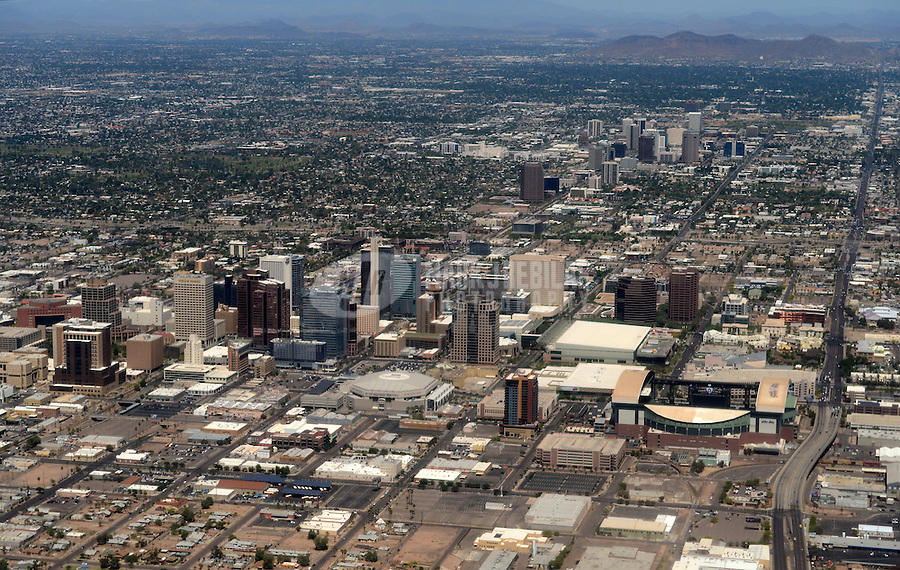 aerial downtown Phoenix Arizona mountains desert urban sprawl city town horizon buildings skyscraper Chase Field US Airways Center sports stadium Arizona Diamondbacks Phoenix Suns baseball basketball road street condo condos hotel residential business urban industrial