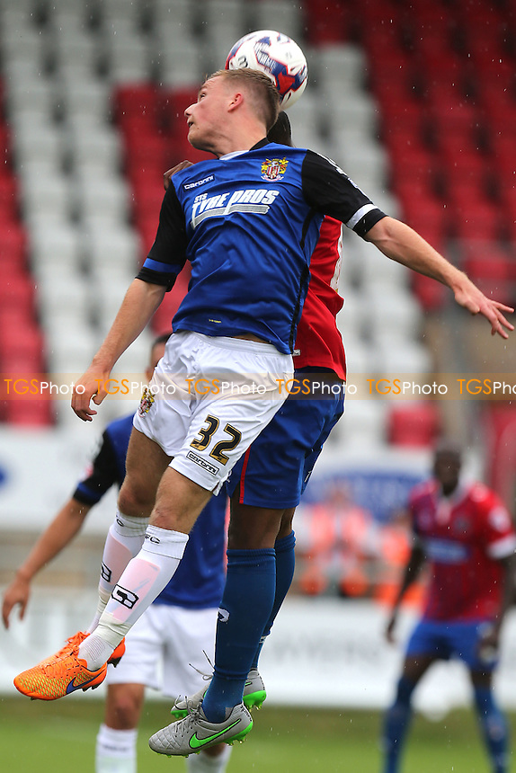 Tom Conlon of Stevenage and Nyron Nosworthy of Dagenham during Dagenham and Redbridge vs Stevenage, Sky Bet League 2 Football at the London Borough of Barking and Dagenham Stadium, London, England on 29/08/2015
