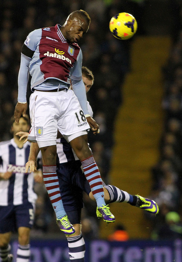 Aston Villa's Yacouba Sylla rises above West Bromwich Albion's Gareth McAuley.<br /> <br /> Photo by James Marsh/CameraSport<br /> <br /> Football - Barclays Premiership - West Bromwich Albion v Aston Villa - Monday 25th November 2013 - The Hawthorns - West Bromwich<br /> <br /> &copy; CameraSport - 43 Linden Ave. Countesthorpe. Leicester. England. LE8 5PG - Tel: +44 (0) 116 277 4147 - admin@camerasport.com - www.camerasport.com