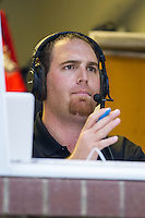 Kannapolis Intimidators Director of Media Relations Josh Feldman calls the game against the Savannah Sand Gnats on radio at CMC-Northeast Stadium on June 9, 2014 in Kannapolis, North Carolina.  The Intimidators defeated the Sand Gnats 4-2.  (Brian Westerholt/Four Seam Images)