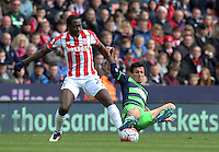 Swansea City's Jack Cork tackles Stoke City's Giannelli Imbula during the Barclays Premier League match between Stoke City and Swansea City played at Britannia Stadium, Stoke on April 2nd 2016
