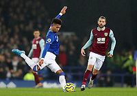 26th December 2019; Goodison Park, Liverpool, Merseyside, England; English Premier League Football, Everton versus Burnley; Mason Holgate of Everton plays a long pass across the pitch - Strictly Editorial Use Only. No use with unauthorized audio, video, data, fixture lists, club/league logos or 'live' services. Online in-match use limited to 120 images, no video emulation. No use in betting, games or single club/league/player publications