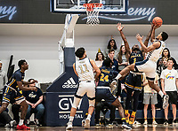 WASHINGTON, DC - FEBRUARY 22: David Betty #1 of La Salle defends a shot by Justin Williams #4 of George Washington during a game between La Salle and George Washington at Charles E Smith Center on February 22, 2020 in Washington, DC.
