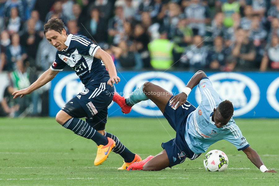 MELBOURNE, 17 May 2015 - Mark MILLIGAN (5) of the Victory and Bernie IBINI of Sydney fight for the ball in the grand final of the 2014-15 A-League match between Sydney FC and Melbourne Victory at AAMI Park in Melbourne, Australia. Victory won 3-0. Photo Sydney Low. This image is not for sale on this web site. Contact zumapress.com for licensing.