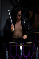 Performers play taiko drum during a Mangekyo performance by Wadaiko group, DRUM TAO in Lumine 0 theatre, Shinjuku, Tokyo, Japan, Friday November 16th 2018. The Mangekyo  performance includes koto and shamisen music along with traditional  and contemporary taiko drumming and acrobatics. Organised by the Japan Tourist bureau (JTB) and the Japanese Government to entertain foreign visitors in readiness for the 2020 Tokyo Olympics. the performances run to the end of November and utilise state of the art projection mapping by TeamLab.