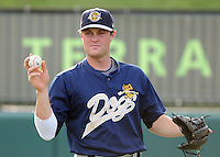 Infielder Garrison Lassiter (6) of the Charleston RiverDogs, Class A affiliate of the New York Yankees, prior to a game against the Greenville Drive on July 31, 2011, at Fluor Field at the West End in Greenville, South Carolina. (Tom Priddy/Four Seam Images)