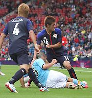 Men's Olympic Football match Spain v Japan on 26.7.12...Inigo Martinez of Spain tackles Hotaru Yamaguchi of Japan, during the Spain v Japan Men's Olympic Football match at Hampden Park, Glasgow............