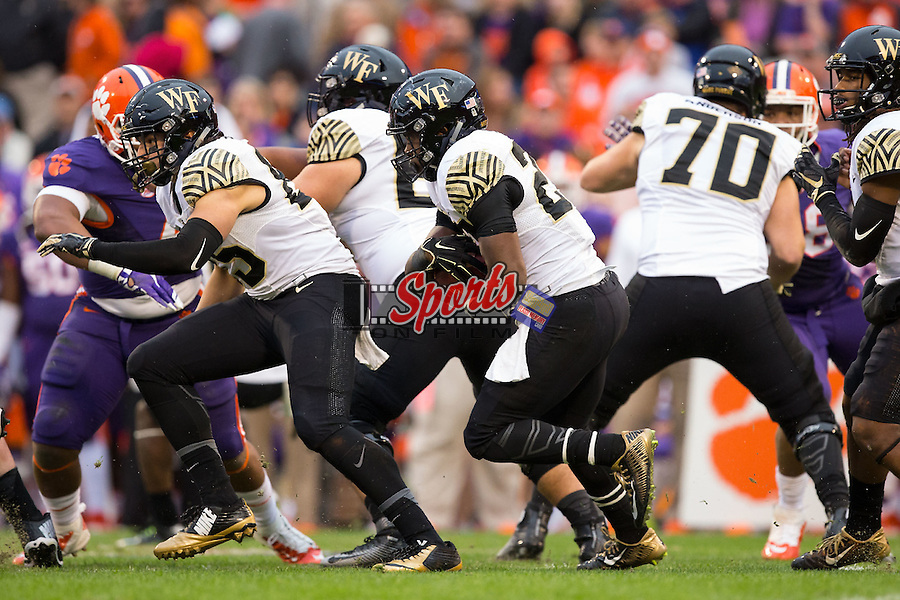 Tyler Bell (27) of the Wake Forest Demon Deacons looks for running room during first half action against the Clemson Tigers at Memorial Stadium on November 21, 2015 in Clemson, South Carolina.  The Tigers defeated the Demon Deacons 33-13.   (Brian Westerholt/Sports On Film)