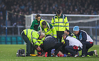 Peter Murphy of Morecambe lays injured before being stretchered off during the Sky Bet League 2 match between Wycombe Wanderers and Morecambe at Adams Park, High Wycombe, England on 2 January 2016. Photo by Andy Rowland / PRiME Media Images