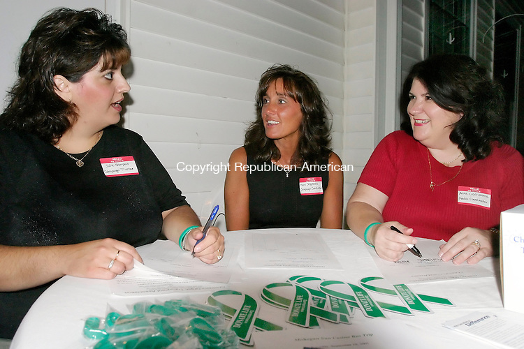"""NAUGATUCK, CT - 30 JULY 2005 -073005JS11--Campaign trustee  Julie Sampaio, left, talks with other fund-raising committee members Kara Vermilya Sequenzia, campaign coordinator, center, and Anne Ciacciarella, media coordinator, right, during a kick off planning meeting at Jesse Camile's Restaurant in Naugatuck on Saturday to organize fundraising efforts for Ashely Silva Galvao, a 15-month-old Naugatuck baby born with """"short gut syndrome"""". Event organizers hope to generate as much participation and money from volunteers to help the gril, show is waiting for a small bowel and liver transplant. The committee will hold a benefit fundraiser Sunday, August 7 at Lake Quassapaug Amusement Park in Middlebury. For more information or tickets contact Kara Vermilya Sequenzia at (203) 723-5562, Anne Ciacciarella at (203) 729-8886 or Julie Sampaio at (203) 720-0410.     --Jim Shannon Photo--Anne Ciacciarella; Julie Sampaio; Kara Vermilya Sequenzia, Ashely Silva Galvao   are CQ"""