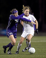 "Boston College forward Kristen Mewis (19) dribbles as University of Washington defender Molly Boyd (25) pressures. In overtime, Boston College defeated University of Washington, 1-0, in NCAA tournament ""Elite 8"" match at Newton Soccer Field, Newton, MA, on November 27, 2010."