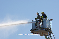 63818-022.11 Firefighters extinguishing warehouse fire using aerial ladder truck, Salem, IL