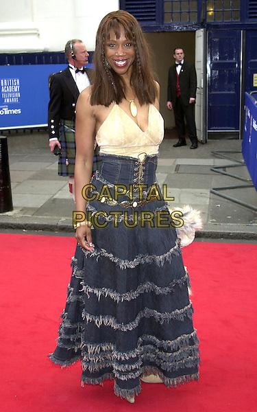 TRISHA GODDARD.BAFTA Television Awards, London, 21st April 2002..full length fashion disaster denim ruffle skirt lace up.Ref:PL.©Capital Pictures.sales@capitalpictures.com.www.capitalpictures.com