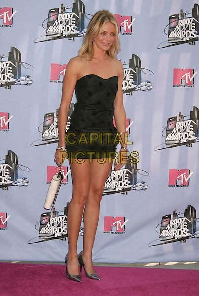 CAMERON DIAZ.2007 MTV Movie Awards held at the Gibson Amphitheater, Universal City, California, USA..June 3rd, 2007.full length black dress strapless polka dot mini silver shoes white bag purse .CAP/ADM/RE.©Russ Elliot/AdMedia/Capital Pictures *** Local Caption *** ...
