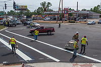 A striping crew adds lines and dividers to an intersection along Westerville Road as construction on the section leading into Westerville nears completion.<br /> <br /> A striping crew completes the broad stripes marking the pedestrian crossing on Dempsey road at Westerville Road as crews near the end of more than a year of construction to widen the roadway adding curbs and more turn lanes at the intersection. the changes also  changed the grade of Dempsey road approaching Westerville Road and eliminated the tight turn radius that plagued the intersection.