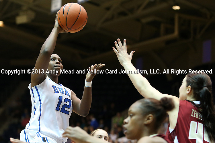 27 January 2013: Duke's Chelsea Gray (12) shoots over Boston College's Katie Zenevitch (45). The Duke University Blue Devils played the Boston College Eagles at Cameron Indoor Stadium in Durham, North Carolina in an NCAA Division I Women's Basketball game. Duke won the game 80-56.