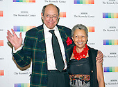 Lawyer Gordon J. Davis, who serves as a director of the John F. Kennedy Center for the Performing Arts, and his wife, Peggy, arrive for the formal Artist's Dinner honoring the recipients of the 38th Annual Kennedy Center Honors hosted by United States Secretary of State John F. Kerry at the U.S. Department of State in Washington, D.C. on Saturday, December 5, 2015. The 2015 honorees are: singer-songwriter Carole King, filmmaker George Lucas, actress and singer Rita Moreno, conductor Seiji Ozawa, and actress and Broadway star Cicely Tyson.<br /> Credit: Ron Sachs / Pool via CNP