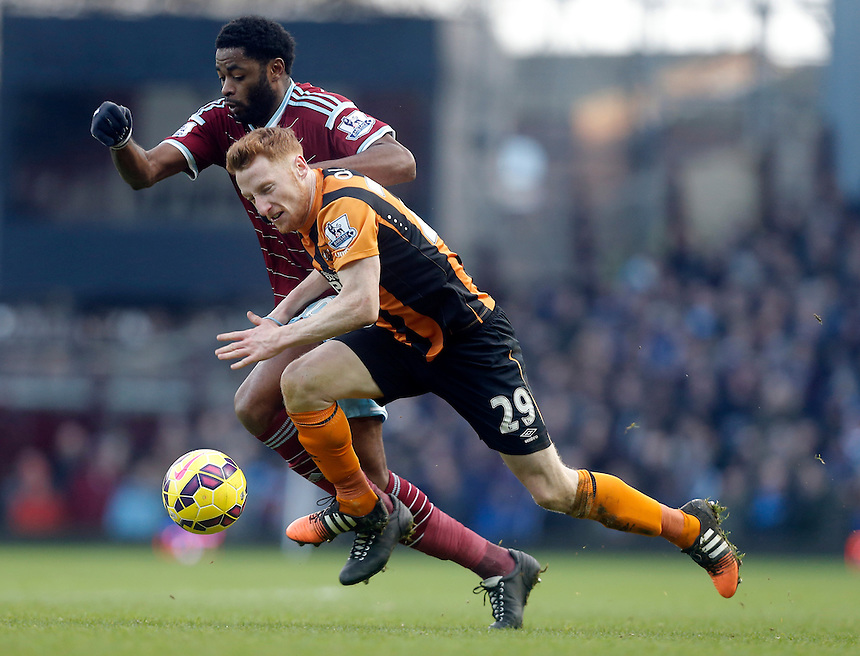 Hull City's Stephen Quinn under pressure from  West Ham United's Alex Song<br /> Photographer Kieran Galvin/CameraSport<br /> <br /> Football - Barclays Premiership - West Ham United v Hull City - Sunday 18th January 2015 - Boleyn Ground - London<br /> <br /> &copy; CameraSport - 43 Linden Ave. Countesthorpe. Leicester. England. LE8 5PG - Tel: +44 (0) 116 277 4147 - admin@camerasport.com - www.camerasport.com